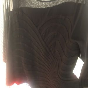 Top with shear sleeves and sweetheart neck. NWT